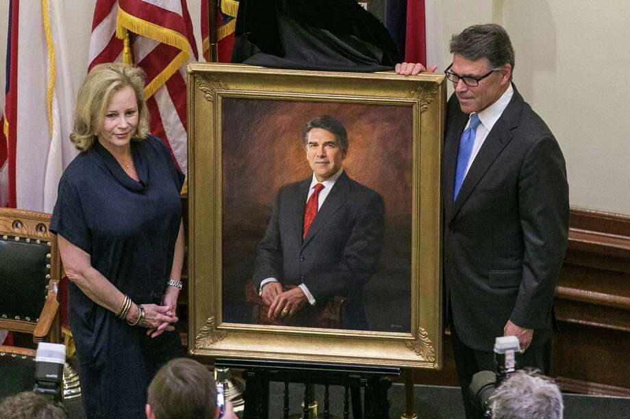 Former Governor Rick Perry and former First Lady, Anita Perry, pose for a picture with Perry's portrait by artist James Tennison following Perry's installation ceremony held at the State Capitol rotunda in Austin, Texas, on Friday, May 6, 2016. RODOLFO GONZALEZ / AUSTIN AMERICAN-STATESMAN Photo: RODOLFO GONZALEZ, AMERICAN-STATESMAN / AMERICAN-STATESMAN