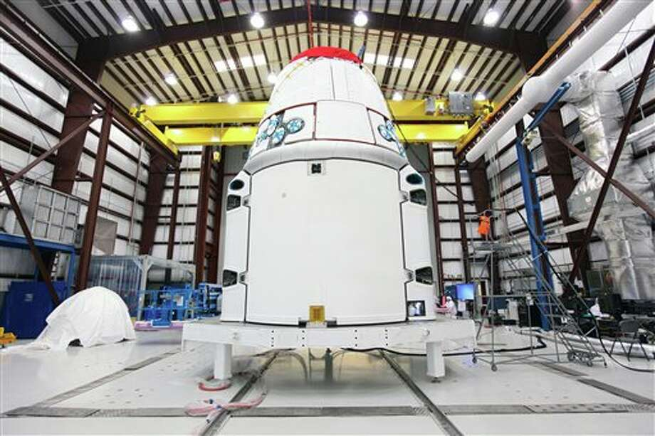 FILE - This Jan. 12, 2013 photo provided by NASA shows the SpaceX Dragon vehicle inside a processing hangar at Cape Canaveral Air Force Station in Cape Canaveral, Fla. SpaceX has scheduled another launch attempt Friday, April 18, 2014 to the International Space Station. NASA confirmed the launch date Wednesday, April 16, 2014, two days after a last-minute rocket leak delayed the delivery mission. Stormy weather, however, is forecast Friday. Saturday is the backup launch date. (AP Photo/NASA, Kim Shiflett) Photo: Kim Shiflett / NASA