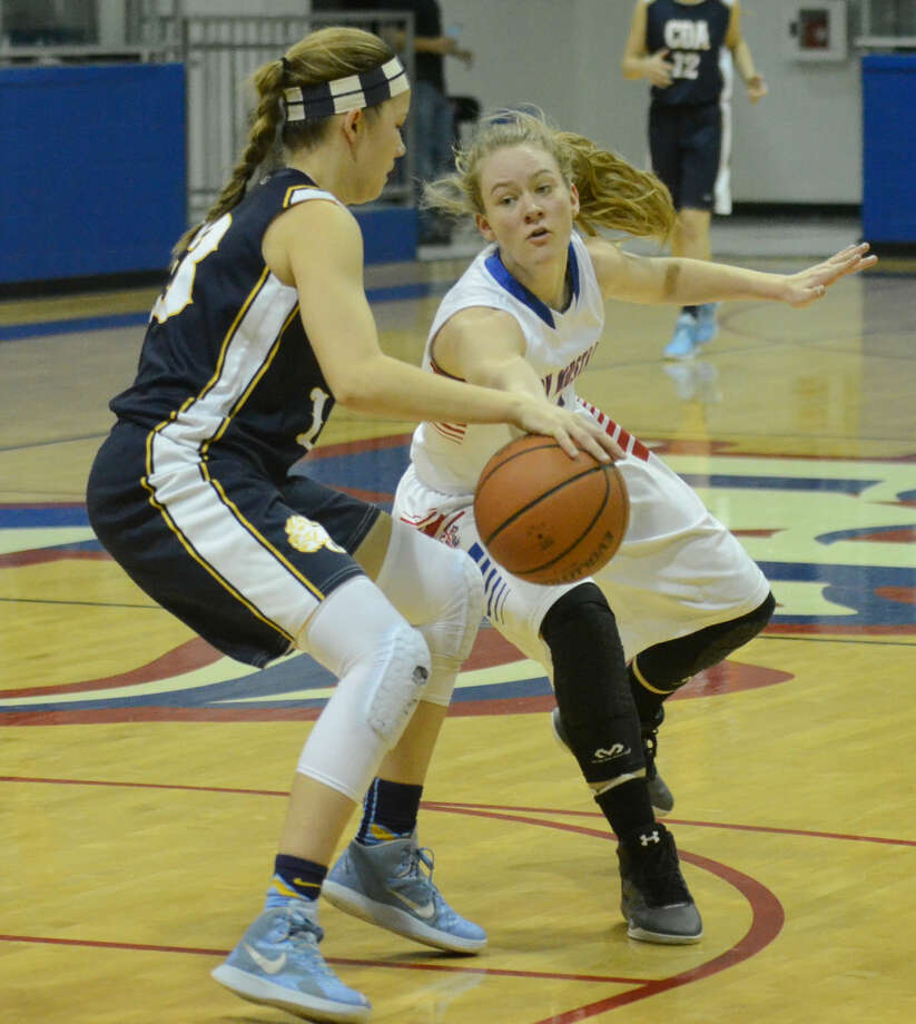 Midland Christian's Megan Ashton (5) knocks the ball away from Coram Deo's Piper Bradenburger (13) on Saturday, Jan. 30. 2016, at McGraw Events Center. James Durbin/Reporter-Telegram Photo: James Durbin
