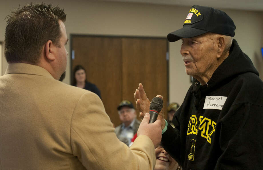 Jeremy West, director for the next Honor Flight in May, speaks with Manuel Herrera, the first veteran chosen for the next flight during a press conference Thursday, 1-29-15. Tim Fischer\Reporter-Telegram Photo: Tim Fischer