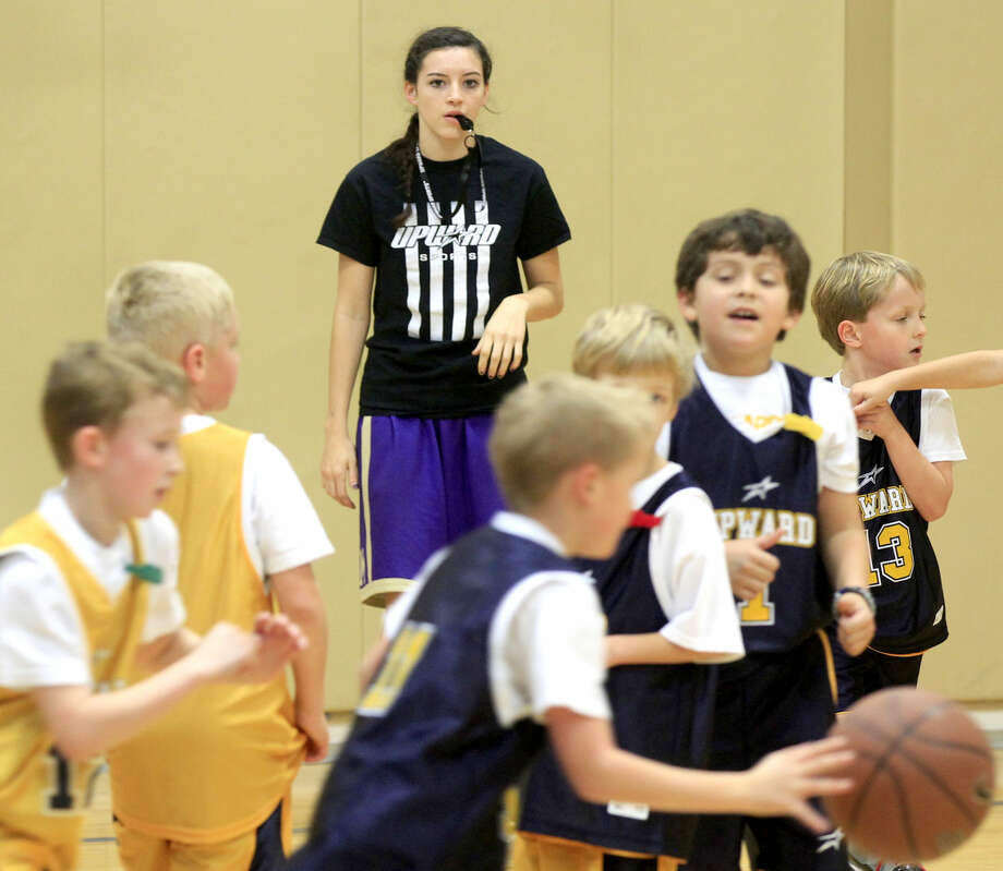 Midland High girls basketball player Miranda Mast officiates a youth basketball game Saturday, Jan. 31, 2015 at the First Baptist Church activities building. James Durbin/Reporter-Telegram
