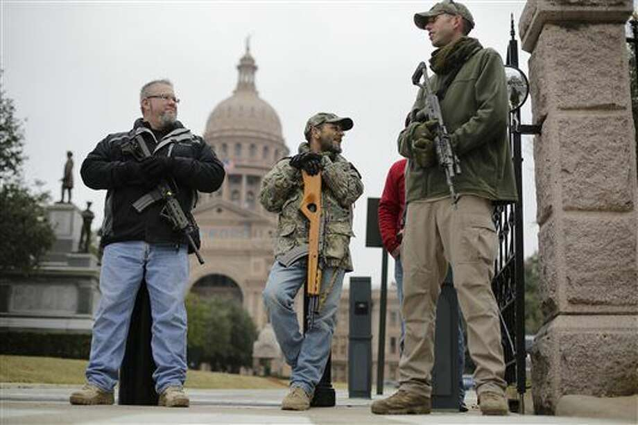 FILE - In this Jan. 13, 2015 file photo, gun rights advocates carry rifles while protesting outside the Texas Capitol in Austin, Texas. Although Texas has more than 800,000 concealed handgun license holders, it is one of only six states that don't allow open carry, a ban that dates almost to the Civil War. But open carry looked primed to pass this year with strong support from Gov. Greg Abbott and other top Republicans who have dominated state politics for two decades. (AP Photo/Eric Gay, File) Photo: Eric Gay