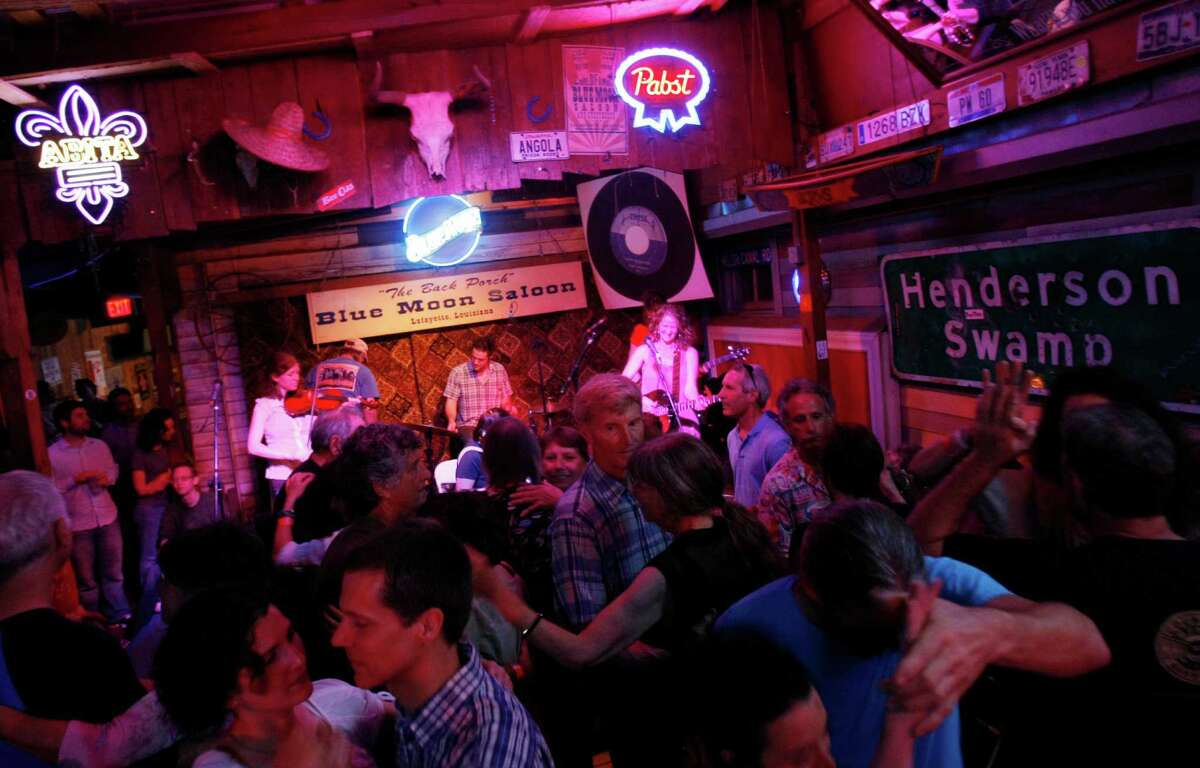 Patrons dance to the music of Cajun band Bonsoir Catin at the Blue Moon Saloon in Lafayette, La.