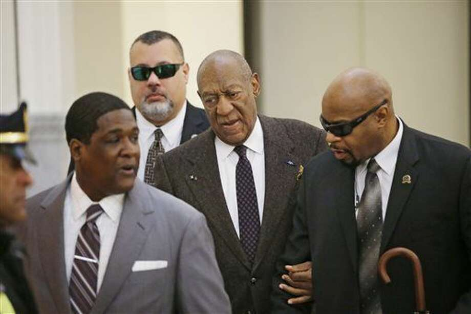 Actor and comedian Bill Cosby arrives for a court appearance Wednesday, Feb. 3, 2016, in Norristown, Pa. Cosby was arrested and charged with drugging and sexually assaulting a woman at his home in January 2004. A judge will decide whether to dismiss a sexual assault case against the comedian over an unwritten promise of immunity that a former prosecutor says he gave Cosby's now-deceased lawyer. (Ed Hille/The Philadelphia Inquirer via AP, Pool Photo: Ed Hille