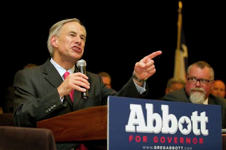 FILE - In this Nov. 1, 2013, file photo, Texas Attorney General Greg Abbott speaks at a convention of the Combined Law Enforcement Associations of Texas in Austin, Texas. Public education is emerging as a central issue in the Texas governor's race between Republican Abbott and Democratic state Sen. Wendy Davis. (AP Photo/Austin American-Statesman, Jay Janner, File) Photo: Jay Janner / Austin American-Statesman