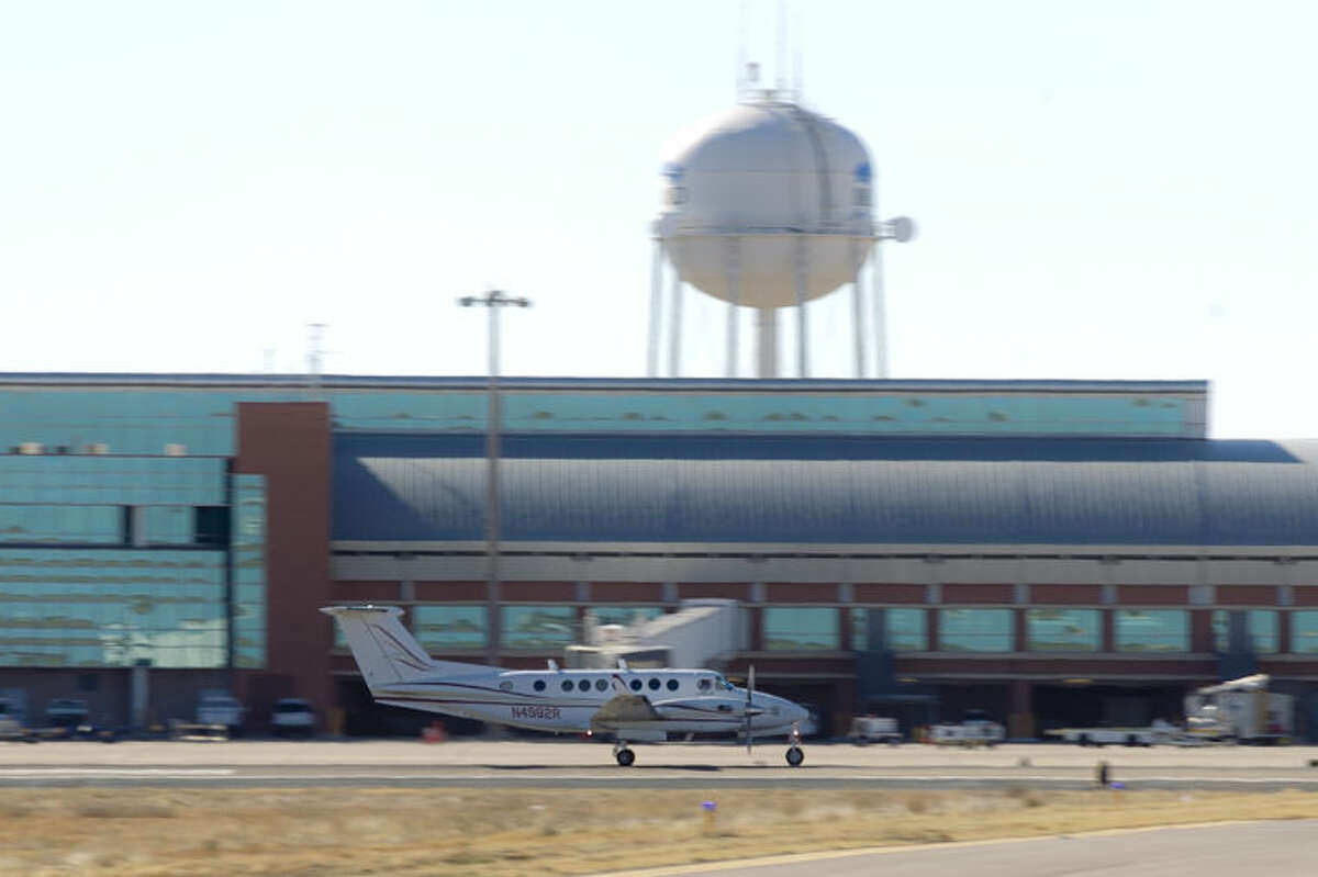 A private aircraft takes off from Midland International Airport, Feb. 13, 2014. The airport has received its spaceport designation from the Federal Aviation Administration.