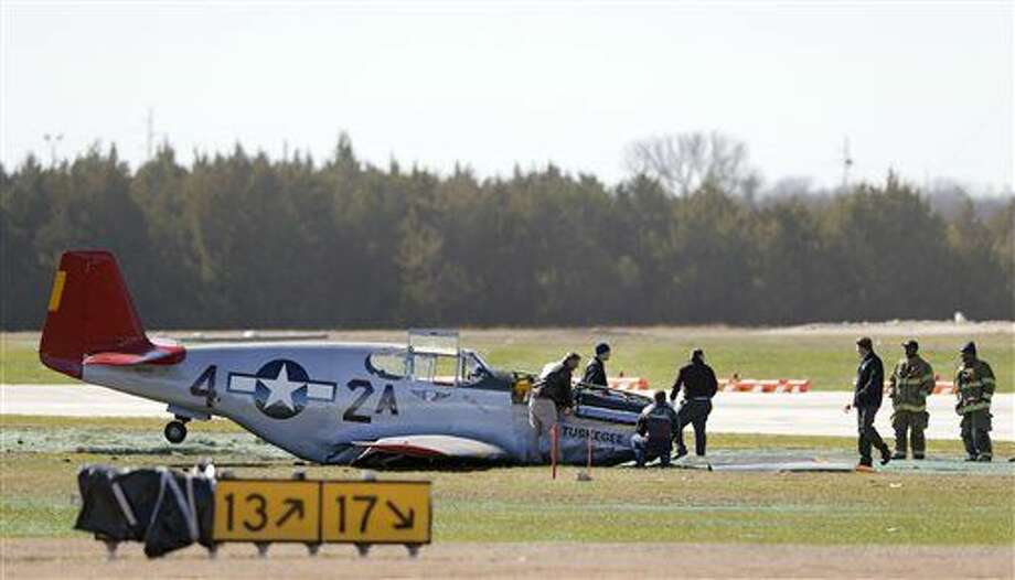 A single seat P-51C Mustang rests after making an emergency landing at Dallas Executive Airport in Dallas on Wednesday, Feb. 3, 2016. The World War II-era military plane made a belly landing at the airport Wednesday. Officials said the pilot wasn't injured. (Vernon Bryant/The Dallas Morning News via AP) MANDATORY CREDIT Photo: Vernon Bryant