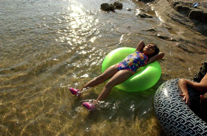 Jordan Salinas of Odem relaxes on her inner tube on the Blanco River near Wimberley.