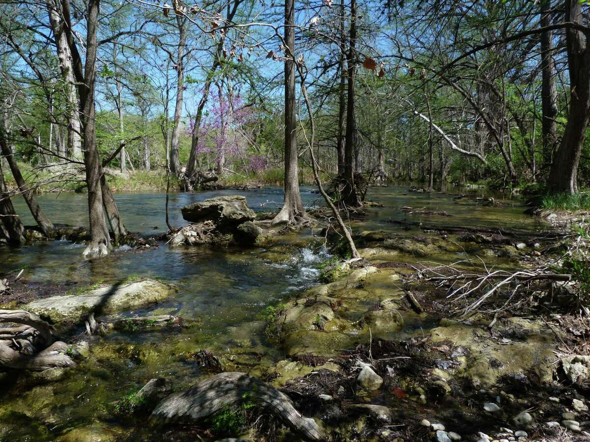 A hike along Cypress Creek in Wimberley starts on the town square and ends at the famous Blue Hole, considered one of the best swimming holes in Texas.