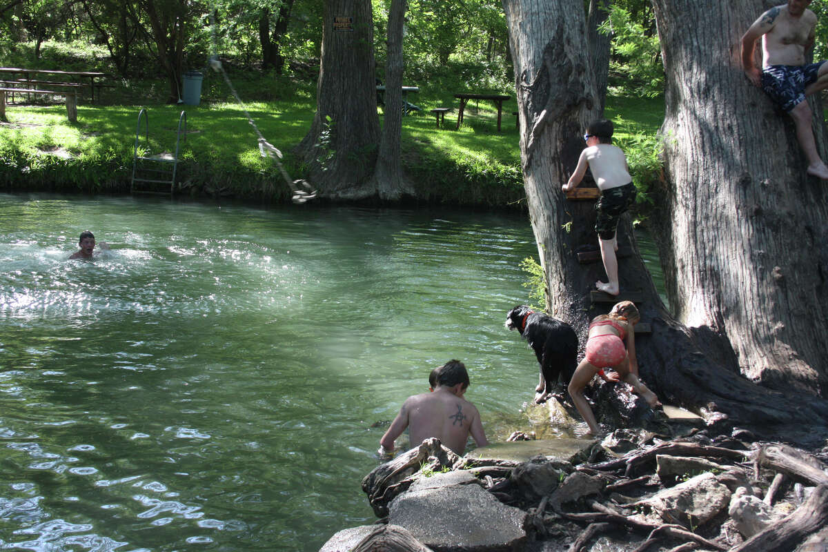 Blue Hole Regional Park Take advantage of opportunities for swimming, picnicking and jumping off rope swings in this lush Texas forest. Address: 100 Blue Hole Rd. Learn more:http://wimberleybluehole.com/