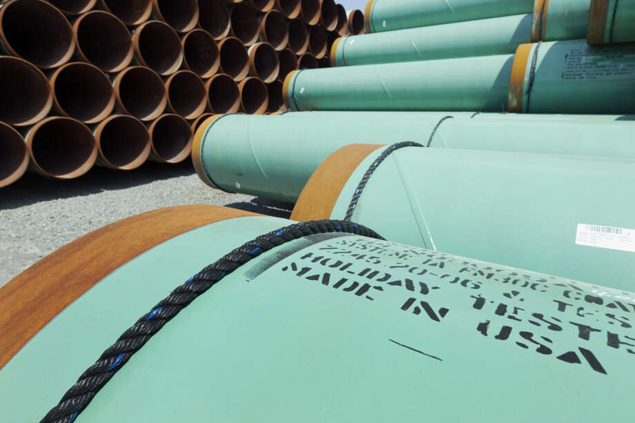 This May 24, 2012 file photo shows some of about 500 miles worth of coated steel pipe manufactured by Welspun Pipes, Inc., originally for the Keystone oil pipeline, stored in Little Rock, Ark. Photo: Danny Johnston