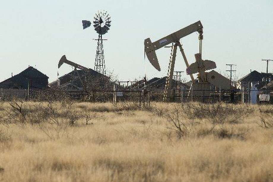 An oil pump in Midland, Texas, Jan. 29, 2016. Over the last year the biggest oil companies have shown the most resilience in the face of plunging oil prices. But now even the likes of ExxonMobil, BP and Chevron are beginning to lose their buoyancy, as prices continue to fall. (Michael Stravato/The New York Times)