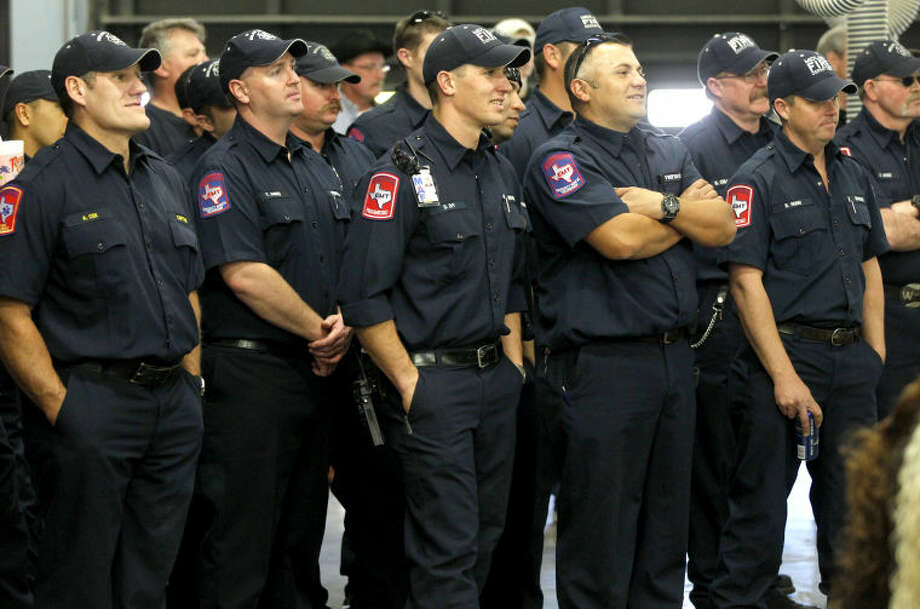 Members of the Midland Fire Department look on during a ceremony commemorating Fire Training Chief Steve Forbes for his service and celebrating his retirement from the Midland Fire Department on Wednesday at the Central Fire Station on Wall Street. James Durbin/Reporter-Telegram Photo: JAMES DURBIN