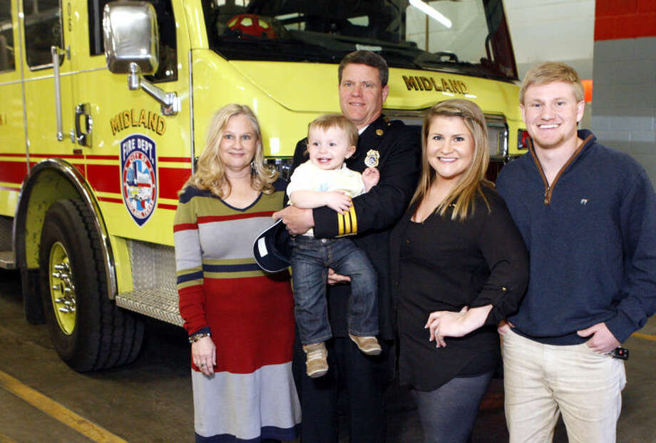 Fire Training Chief Steve Forbes poses for a photo with his wife Betty, grandson Sawyer, daughter Holly and son Trent after a ceremony commemorating his service and celebrating his retirement from the Midland Fire Department on Wednesday at the Central Fire Station on Wall Street. James Durbin/Reporter-Telegram Photo: JAMES DURBIN
