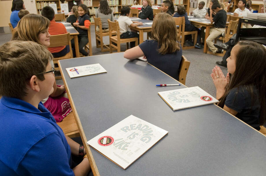 """Henderson Elementary 4-6 graders in Read 180 see their published stories in book form for the first time Tuesday 2-3-15, entitled """"Reading is Like."""" Tim Fischer\Reporter-Telegram Photo: Tim Fischer"""