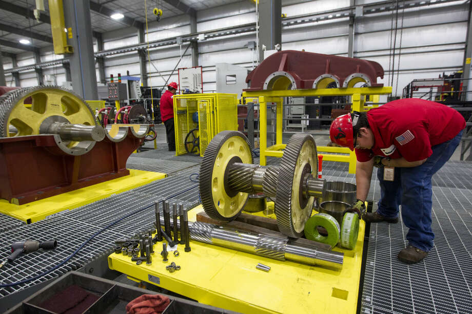 Stephan Finch works with gears at the Weatherford rod-pump manufacturing plant Thursday, June 26, 2014, in Katy. ( Brett Coomer / Houston Chronicle ) Photo: Brett Coomer