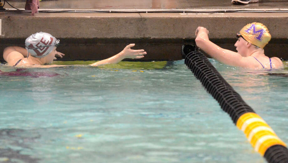 Lee High's Keely Martin (left) and Midland High's Kile Carriger (right) shake hands after competing in the girls' 200 yard IM during the District 3-6A Swimming and Diving Championships Saturday, Jan. 24, 2015 at the Mabee Aquatic Center. James Durbin/Reporter-Telegram Photo: James Durbin