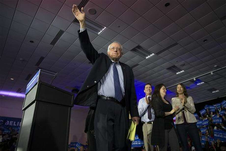 Democratic presidential candidate Sen. Bernie Sanders, I-Vt., waves during a caucus night party, on Monday, Feb. 1, 2016, in Des Moines, Iowa. (AP Photo/Evan Vucci) Photo: Evan Vucci