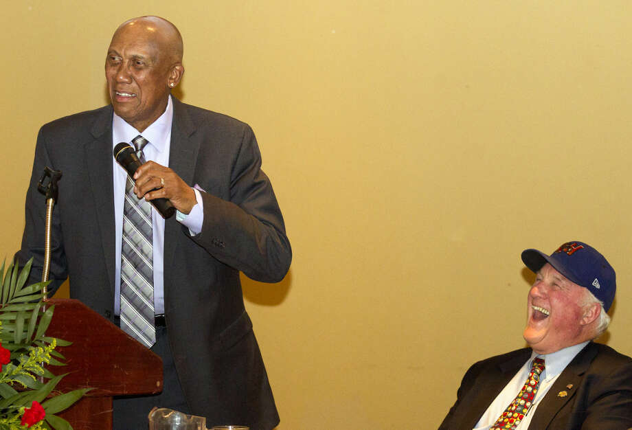 Former Major League baseball player Ferguson Jenkins speaks, while RockHounds co-owner Miles Prentice laughs and looks on during the annual West Texas Sports Banquet on Thursday, Feb. 5, 2015 at Midland Country Club. James Durbin/Reporter-Telegram Photo: James Durbin