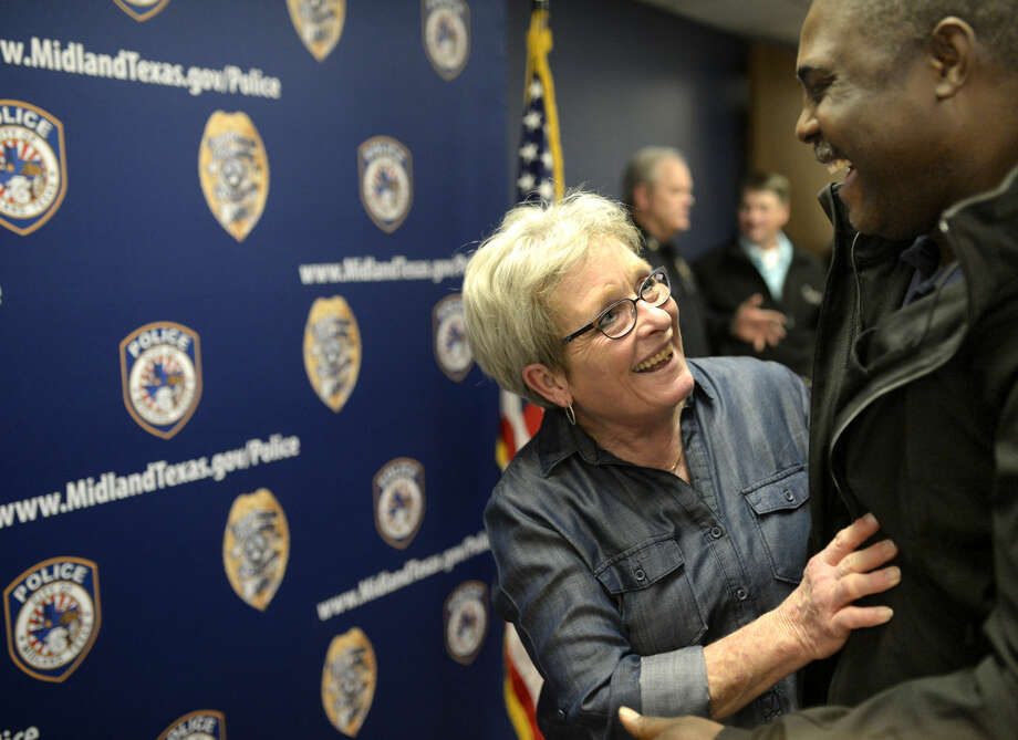 Lt. Bobbie Jo Land hugs Officer Larry Woodruff during her retirement party, Friday, Jan. 29, 2016 at the Midland Police Department. James Durbin/Reporter-Telegram Photo: James Durbin