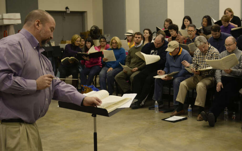 Gregory Pysh leads members of Midland-Odessa Symphony and Chorale during rehearsal for an upcoming concert. Tim Fischer\Reporter-Telegram Photo: Tim Fischer