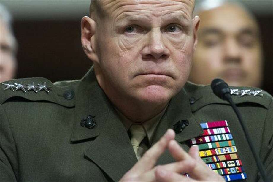 Marine Corps Commandant Gen. Robert Neller testifies on Capitol Hill in Washington, Tuesday, Feb. 2, 2016, before the Senate Armed Services Committee hearing to examine the implementation of the decision to open all ground combat units to women. (AP Photo/Cliff Owen) Photo: Cliff Owen