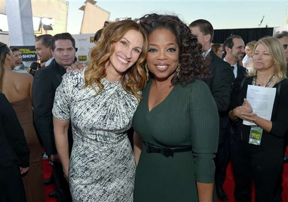 Julia Roberts, left, and Oprah Winfrey arrive at the 19th annual Critics' Choice Movie Awards at the Barker Hangar on Thursday, Jan. 16, 2014, in Santa Monica, Calif. (Photo by John Shearer/Invision/AP) Photo: John Shearer / Invision