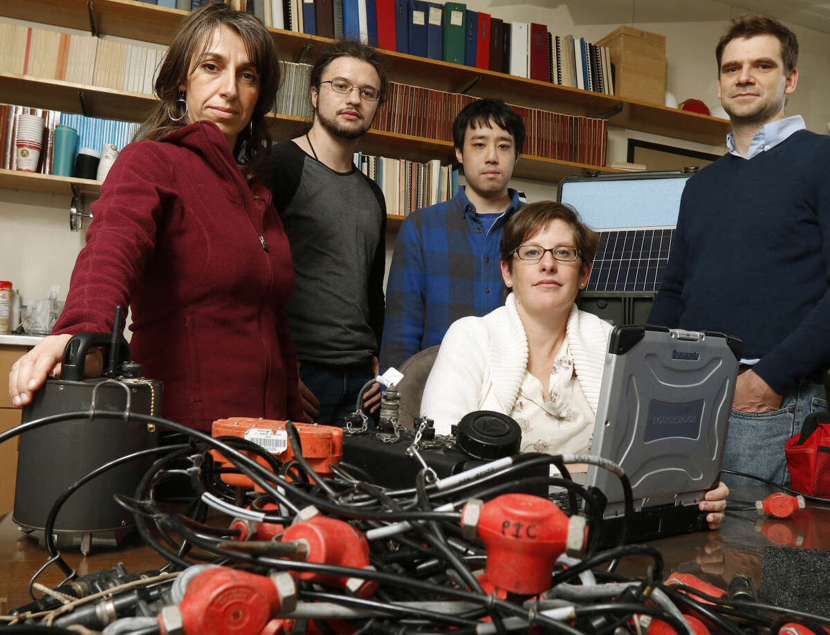 From left, Maria Beatrice Magnani, associate professor of geophysics; Harrison Oldham, grad student; Kevin Kwong, grad student; Heather DeShon, associate professor; and Matt Hornbach, associate professor, pose for a portrait with their seismic equipment used to test the North Texas area for seismic activity at their lab at SMU Jan. 9, 2015 in Dallas. (Nathan Hunsinger/The Dallas Morning News/TNS)