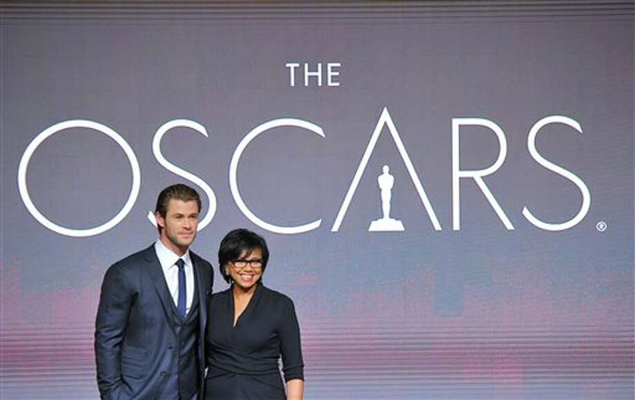Chris Hemsworth, left, and President of the Academy Cheryl Boone Isaacs pose at the 86th Academy Awards nomination ceremony on Thursday, Jan. 16, 2013 in Beverly Hills, Calif. The 86th Annual Academy Awards will take place on Sunday, March 2, at the Dolby Theatre in Los Angeles. (Photo by Vince Bucci/Invision/AP) Photo: Vince Bucci / Invision
