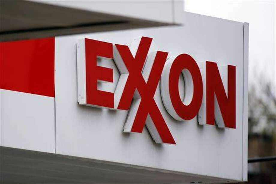 FILE - This April 29, 2014, file photo, shows an Exxon sign at a Exxon gas station in Carnegie, Pa. Exxon Mobil Corp. reports quarterly financial results on Tuesday, Feb. 2, 2016. (AP Photo/Gene J. Puskar, File) Photo: Gene J. Puskar