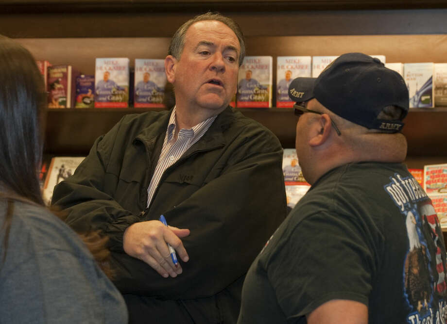 """Mike Huckabee signs copies of his book, """"God, Guns, Grits and Gravy,"""" Friday, 2-6-15, at the Barnes & Noble in Midland. Tim Fischer\Reporter-Telegram Photo: Tim Fischer"""
