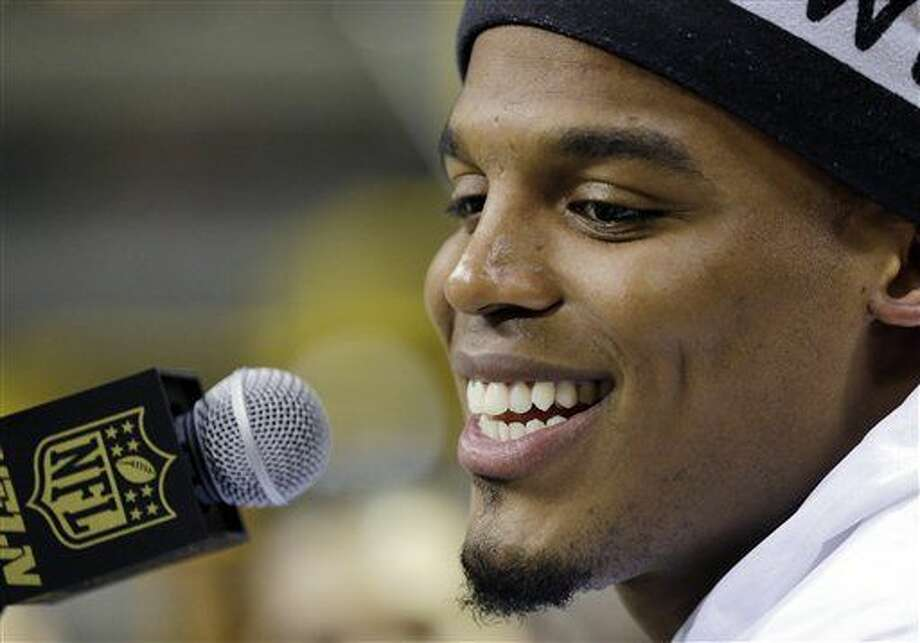Carolina Panthers' Cam Newton answers a question during Opening Night for the NFL Super Bowl 50 football game Monday, Feb. 1, 2016, in San Jose, Calif. (AP Photo/David J. Phillip) Photo: David J. Phillip