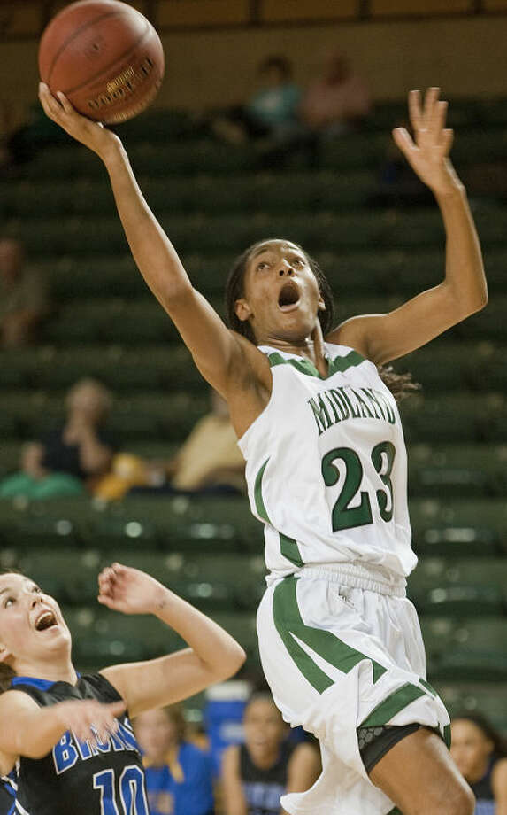 Midland College's Mary Savoy drives around SLC CC's Summer Yack on Nov. 21, 2013 at the WNIT basketball tournament at Chaparral Center. Tim Fischer\Reporter-Telegram Photo: Tim Fischer