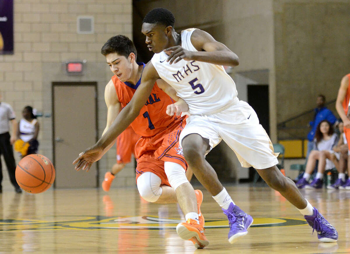 Midland High's Gary Ringo (5) chases down a loose ball against San Angelo Central's Cristian Cardenas (1) on Friday, Feb. 6, 2015 at Chaparral Center. James Durbin/Reporter-Telegram