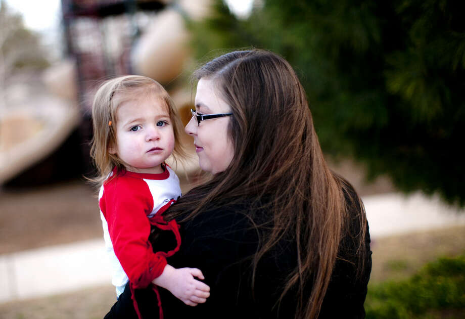 Jessica Faircloth and her 20-month-old daughter Kelbie, who has a congenital heart defect, photographed Tuesday, Feb. 2, 2016, at Grafa Park. James Durbin/Reporter-Telegram Photo: James Durbin