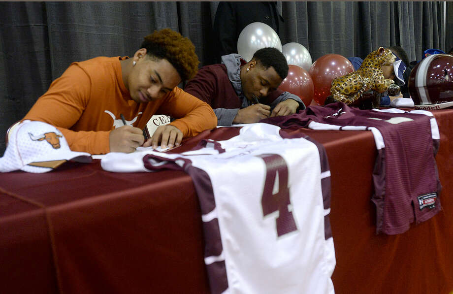 Central High School's P. J. Locke, who will be heading to the University of Texas, and fellow scholarship winning teammates sign their symbolic letters of intent on national college signing day Wednesday morning. Photo taken Wednesday, February 4, 2015 Kim Brent/The Enterprise Photo: Kim Brent