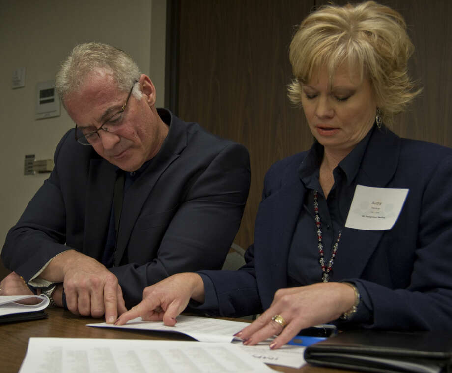 Randy Rowe, executive director of athletics, and Audra Hooker, director of athletics for MISD look over the new UIL districts after they are released Monday 02-01-16 morning at Region 18 Service Center. Tim Fischer/Reporter-Telegram Photo: Tim Fischer