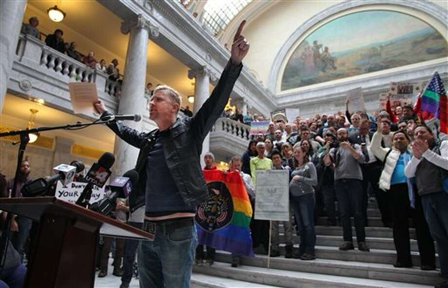 FILE - In this Friday, Jan. 10, 2014, file photo, Troy Williams, a local LGBT organizer, speaks to a crowd of supporters of gay marriage as they gathered to rally and deliver more than 58,000 petition signatures in support of gay marriage to Utah Gov. Gary Herbert at the Utah State Capitol in Salt Lake City. In less than a month, two federal judges have struck down state bans on gay marriage for the same reason, concluding that they violate the Constitution's promise of equal treatment under the law. Although that idea has been the heart of the gay marriage debate for years, the decisions in deeply conservative Oklahoma and Utah offer new momentum for litigants pressing the same argument in dozens of other cases across the country. (AP Photo/Steve C. Wilson, File) Photo: Steve C. Wilson / AP2014