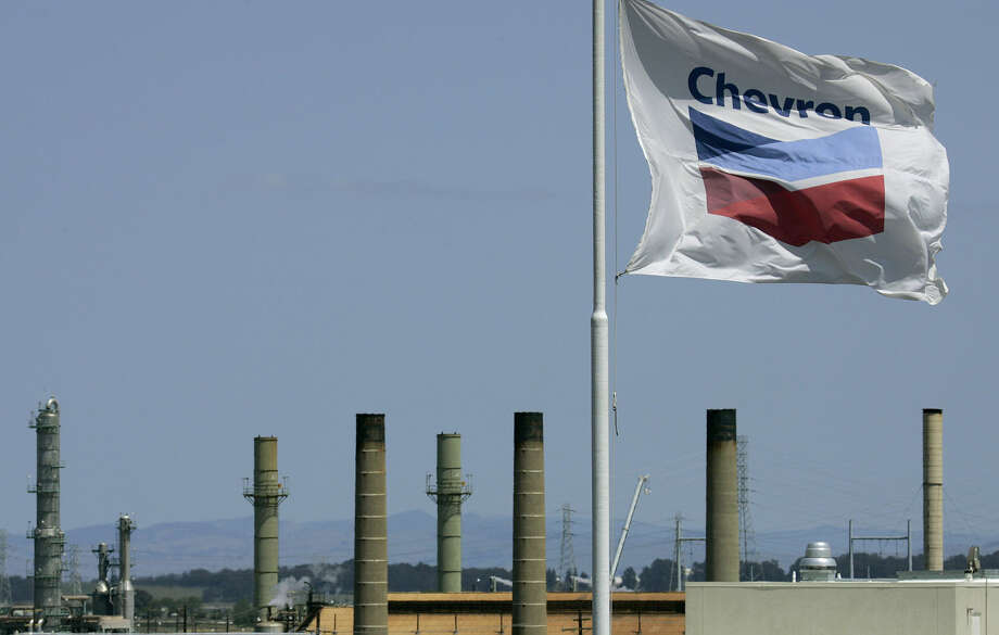 FILE - This April 21, 2008 file photo shows a Chevron flag flying over the Chevron refinery in Richmond, Calif. Chevron Corp. reports quarterly financial results before the market opens on Friday, April 26, 2013. (AP Photo/Ben Margot, File) Photo: Ben Margot
