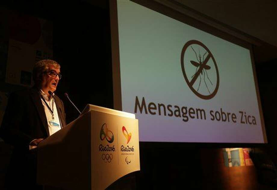 "Mario Andrada, spokesperson for the Rio Olympic Organizing Committee, speaks next to a screen that reads in Portuguese : ""Message about Zika"" during a media briefing in Rio de Janeiro, Brazil, Tuesday, Feb. 2, 2016. Reporters came to hear about ticket sales, venue construction and a reminder that Friday marks six months until the games open. Instead, they got the organizers' medical director Dr. Joao Grangeiro and government health officials assuring the games will be safe; that only pregnant women are in danger from a virus with its epicenter in Brazil. (AP Photo/Silvia Izquierdo) Photo: Silvia Izquierdo"