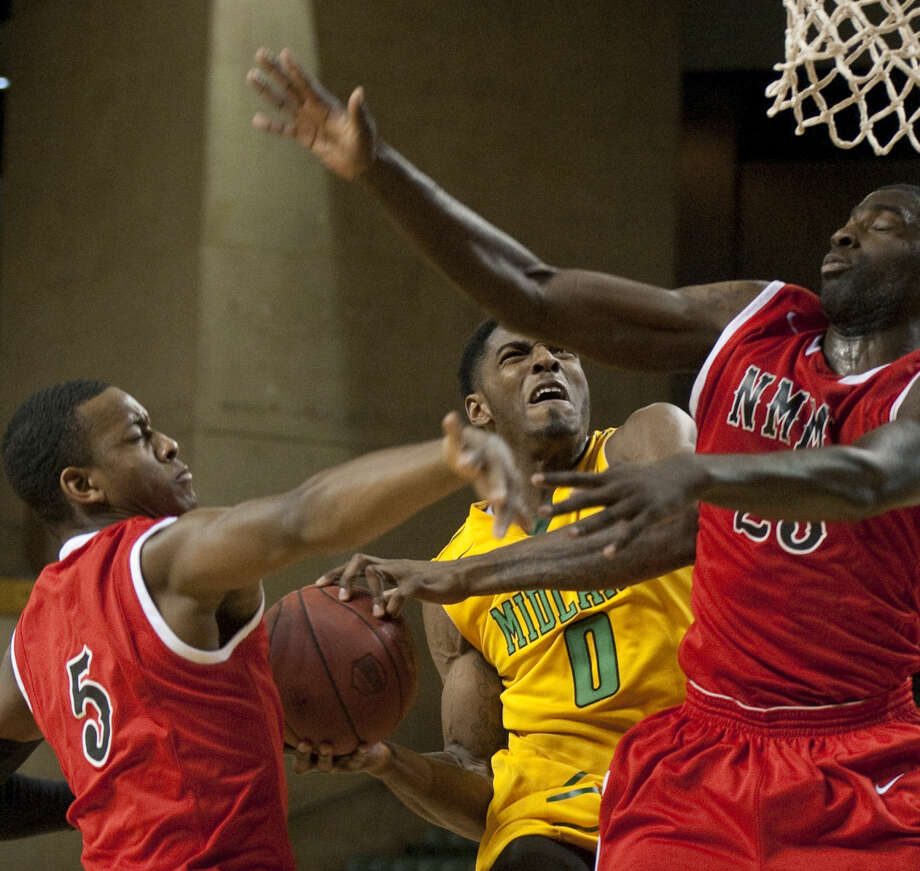 Midland College's Torren Jones goes to the basket as NMMI's Marquis Godfrey and Will Joyce defend Monday, 2-9-15, at the Chaparral Center. Tim Fischer\Reporter-Telegram Photo: Tim Fischer