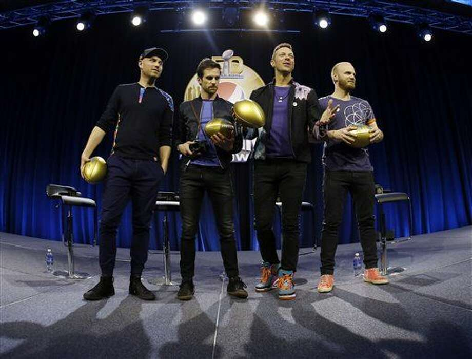 Jonny Buckland, left to right, Guy Berryman, Chris Martin and Will Champion of Coldplay hold footballs during a halftime news conference for the upcoming NFL Super Bowl 50 football game Thursday, Feb. 4, 2016, in San Francisco. (AP Photo/Matt Slocum) Photo: Matt Slocum