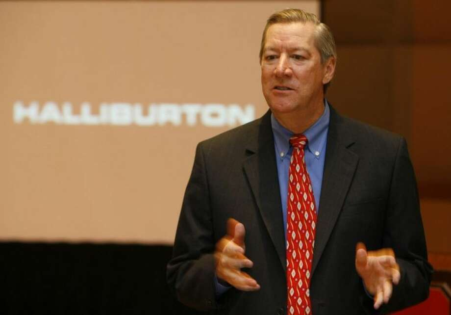 Halliburton CEO Dave Lesar talks with the media after an annual shareholders meeting. Photo: Melissa Phillip/Houston Chronicle File PHoto