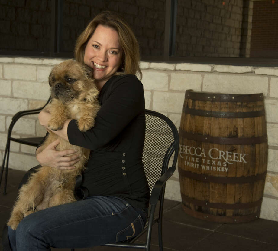 Erica Mann, owner of The Blue Door, holds Groucho, one of the dogs available for adoption at Lone Star Animal Sanctuary. Tuesday 01-19-16 Tim Fischer/Reporter-Telegram Photo: Tim Fischer