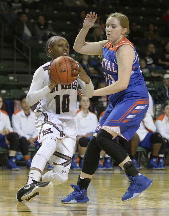 Lee's Braydyn Hill (10) moves the ball against San Angelo Central's Allison Hurst (20) on Friday, Jan. 29, 2016, at Chaparral Center. James Durbin/Reporter-Telegram Photo: James Durbin