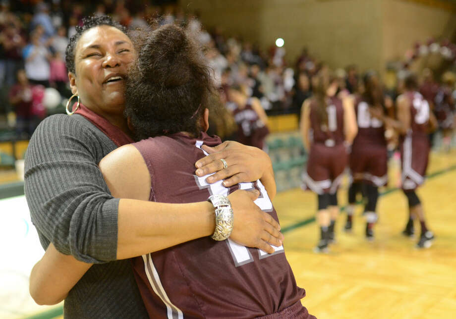 Lee girls basketball head coach Monica Ramirez hugs her daughter Kyra Lewis after Lewis sunk two free throws on a technical foul in the final seconds of play to win the game against Midland High on Tuesday, Feb. 9, 2016, at Chaparral Center. James Durbin/Reporter-Telegram Photo: James Durbin