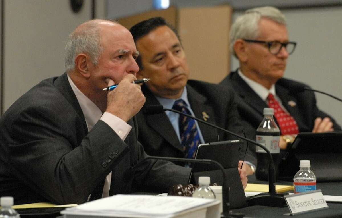 Rep. Tryon Lewis (right), seen here during a legislative hearing about the dune sagebrush lizard, was selected to the Texas Transportation Committee.