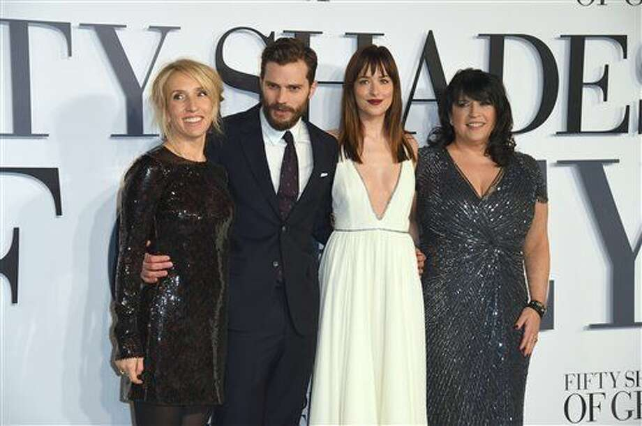 From left, Sam Taylor-Johnson, Jamie Dornan, Dakota Johnson and E.L. James pose for photographers at the UK Premiere of Fifty Shades of Grey, at a central London cinema, Thursday, Feb. 12, 2015. (Photo by Jonathan Short/Invision/AP) Photo: Jonathan Short