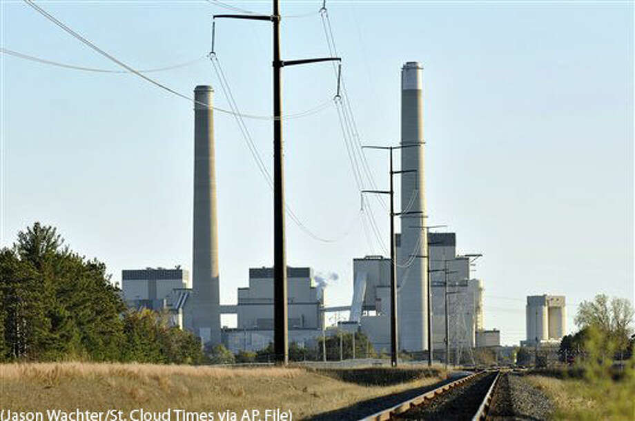 "FILE - This Oct. 20, 2010, file photo, shows Xcel Energy's Sherco Power Plant is shown in Becker, Minn. A divided Supreme Court agreed Feb. 9, 2016, to halt enforcement of President Barack Obama's sweeping plan to address climate change until after legal challenges are resolved. The surprising move is a blow to the administration and a victory for the coalition of 27 mostly Republican-led states and industry opponents that call the regulations ""an unprecedented power grab."" (Jason Wachter/St. Cloud Times via AP, File) Photo: Jason Wachter"