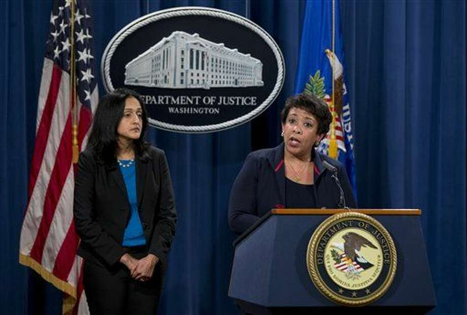Attorney General Loretta Lynch, joined by Principal Deputy Assistant Attorney General Vanita Gupta speaks during a news conference at the Justice Department in Washington, Wednesday, Feb. 10, 2016, about Ferguson, Missouri. The federal government sued Ferguson on Wednesday, one day after the city council voted to revise an agreement aimed at improving the way police and courts treat poor people and minorities in the St. Louis suburb. (AP Photo/Carolyn Kaster) Photo: Carolyn Kaster